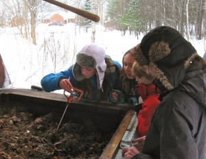 Students Taking temperature of the working compost
