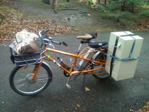 ElMundo with file cabinet and 50# of groceries in basket and pannier on other side.