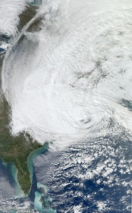 The damage will not be from the weather, but it might be as bad as Sandy (pictured). Photograph by NASA.