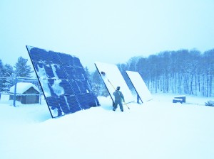 Cleaning off snow from ground-mounted solar panels (PV) with the SnoPro Brum.