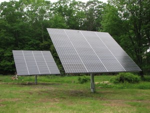 Two 7.2kW Vermont-made solar trackers installed by Net Zero Renewable Energy of Chester, VT power the electric and geothermal needs of a nearby Springfield home.