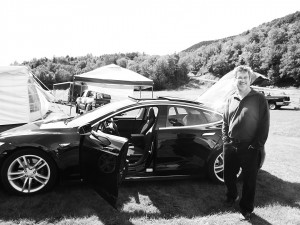 The author, Roger Lohr next to a Tesla, owned by Jason Cooper of Brattleboro, VT.