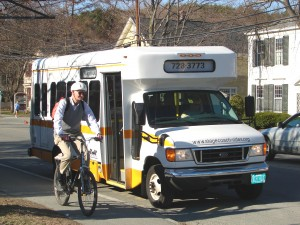 A cyclist and Stagecoach bus in Norwich, Vermont.