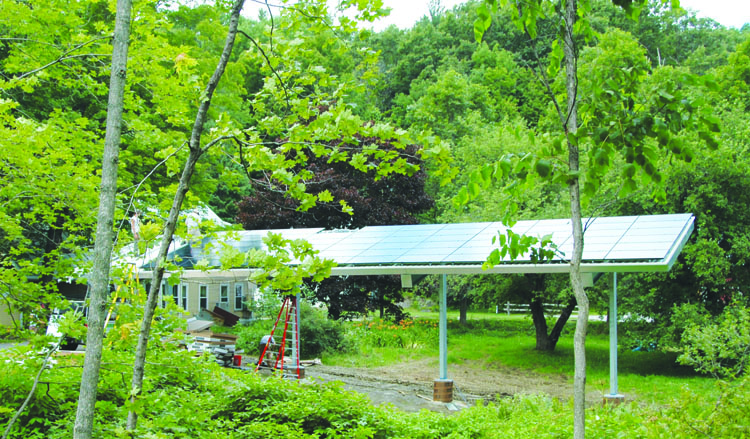 A 17.55 kW photovoltaic installed as a carport at Bill Maclay Architects office building in Waitsfield, VT. It was the final touch in a decade-long process of bringing the offices to net-zero.