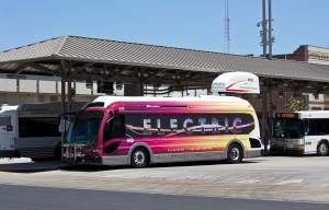 electric bus at a charging station. Photo by SanJoaquinRTD