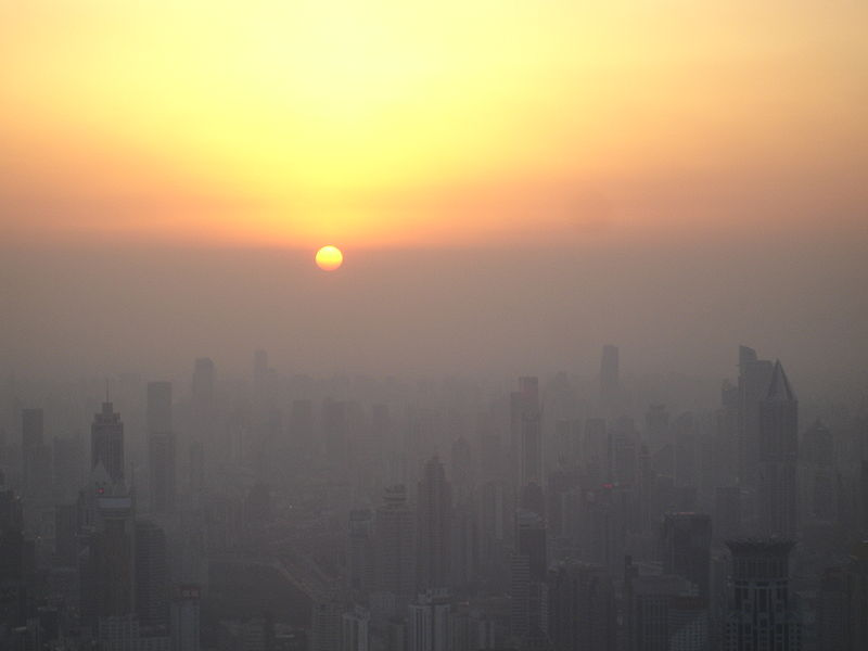 Shanghai smog as the afternoon sun has reached the smog line. Photo by Suicup, Wikimedia Commons.