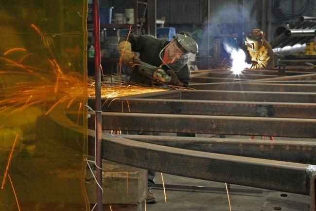 Welders for Specialty Diving Services in the Quonset Business Park working on the Deepwater Wind project. Photo by Sandor Bodo, The Providence Journal