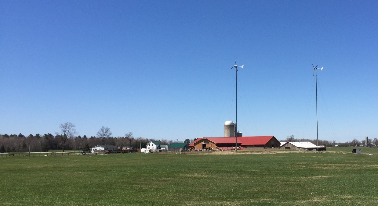 Two windmills stand above a farm in Sheldon, VT. VBM photo.