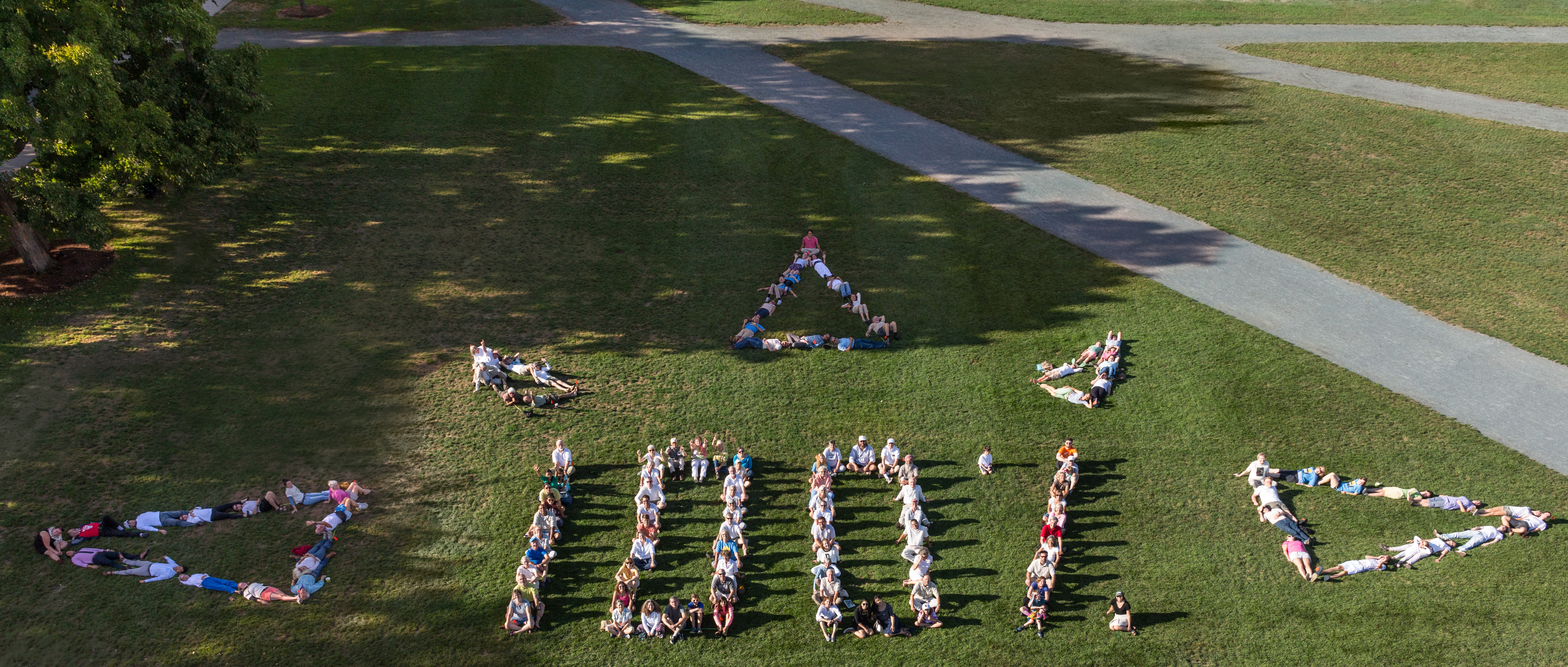 Over 125 people participated in this aerial art photo in Hanover, NH to show their support for 100% renewable energy. Photo: Rob Strong.